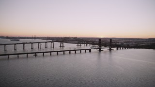 AX93_127 - 4K stock footage aerial video of Newark Bay Bridge, Lehigh Valley Railroad Bridge, Newark Bay, Newark, New Jersey, twilight