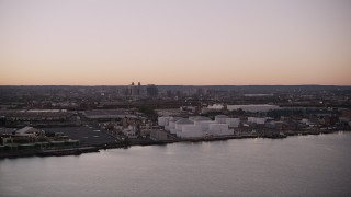 AX93_129 - 4K stock footage aerial video Flying by an oil refinery, Newark Bay, Newark, New Jersey, twilight