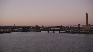 AX93_130 - 4K stock footage aerial video Approaching an oil refinery, factory, Passaic River, Newark, New Jersey, twilight
