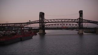 AX93_133 - 4K stock footage aerial video of Lincoln Highway Bridge, Pulaski Skyway Bridge, Newark, New Jersey, twilight