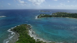 AX96_157 - 5k stock footage stock footage aerial video approach and orbit Little St James Island in sapphire blue waters, St Thomas, Virgin Islands