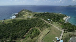AX96_159 - 5k stock footage stock footage aerial video fly over island to approach gold-domed building on Little St James Island, St Thomas, Virgin Islands