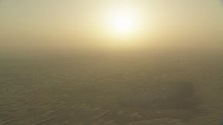 CAP_001_003 - HD stock footage aerial video of the sunrise above sand dunes, Al Selmiyyah, Abu Dhabi, UAE