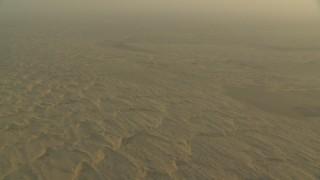 CAP_001_005 - HD stock footage aerial video of tilting to desert sand dunes in Al Selmiyyah, Abu Dhabi, UAE