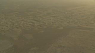 CAP_001_008 - HD stock footage aerial video of sand dunes during a hazy sunrise in Al Gharbia, Abu Dhabi, UAE