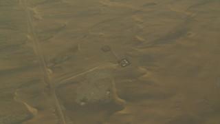 CAP_001_011 - HD stock footage aerial video of orbiting buildings and sand dunes at sunrise, Al Gharbia, Abu Dhabi, UAE