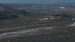 CAP_002_003 - HD stock footage aerial video of a river and autumn trees in Jackson Hole, Wyoming, twilight