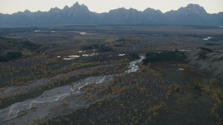 CAP_002_004 - HD stock footage aerial video of autumn trees around a river near mountains, Jackson Hole, Wyoming twilight
