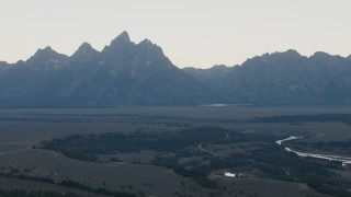 CAP_002_007 - HD stock footage aerial video of rugged mountains in Jackson Hole, Wyoming, twilight