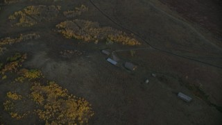 CAP_002_015 - HD stock footage aerial video of barns and autumn trees, Jackson Hole, Wyoming, twilight