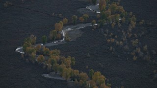 CAP_002_016 - HD stock footage aerial video of a river and autumn trees in Jackson Hole, Wyoming, twilight