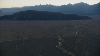 CAP_002_017 - HD stock footage aerial video of approaching Blacktail Butte, Jackson Hole, Wyoming, twilight