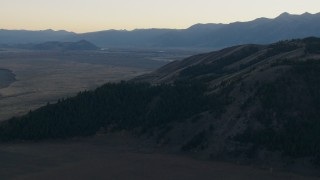 CAP_002_018 - HD stock footage aerial video of flying over Blacktail Butte, Jackson Hole, Wyoming, twilight