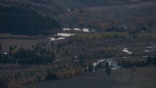CAP_002_019 - HD stock footage aerial video of autumn trees around small lakes and a river, Jackson Hole, Wyoming, twilight