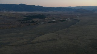 CAP_002_020 - HD stock footage aerial video of autumn trees, hills and a river in Jackson Hole, Wyoming, twilight