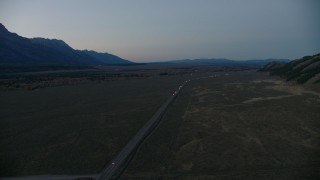 CAP_002_022 - HD stock footage aerial video of flying by Highway 26, Jackson Hole, Wyoming, twilight