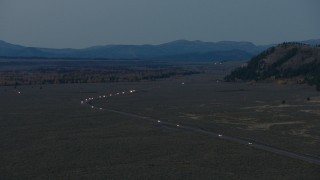 CAP_002_023 - HD aerial stock footage video of light traffic on Highway 26, Jackson Hole, Wyoming, twilight