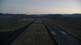 CAP_002_024 - HD stock footage aerial video pan to reveal and fly over Jackson Hole Airport, Wyoming, twilight