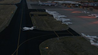 CAP_002_026 - HD stock footage aerial video of a jet taxiing onto the runway at Jackson Hole Airport, Wyoming, twilight