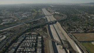 CAP_003_001 - HD stock footage aerial video follow LA River over freeways in South Gate, California
