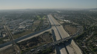 CAP_003_002 - HD stock footage aerial video fly over freeway and follow the LA River in South Gate, California