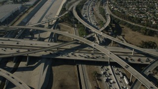 CAP_003_005 - HD stock footage aerial video of heavy traffic on a freeway interchange by the LA River in Lynwood, California