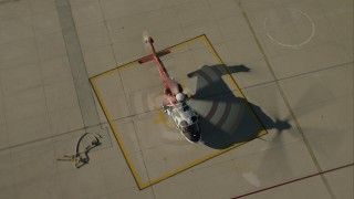 CAP_004_001 - HD stock footage aerial video of a firefighting helicopter on the ground at Van Nuys Airport, California