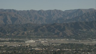 CAP_004_004 - HD stock footage aerial video of Bob Hope International Airport and mountain ridges in Burbank, California