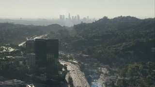 CAP_004_005 - HD stock footage aerial video fly over office building to approach the skyline of Downtown Los Angeles, California