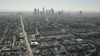 CAP_004_012 - HD stock footage aerial video of approaching the skyline of Downtown Los Angeles, California