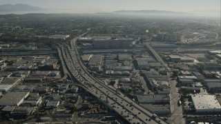 CAP_004_020 - HD stock footage aerial video of light freeway traffic in Boyle Heights, Los Angeles, California