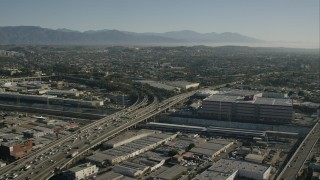 CAP_004_021 - HD stock footage aerial video flyby light traffic on freeway through Boyle Heights, Los Angeles, California