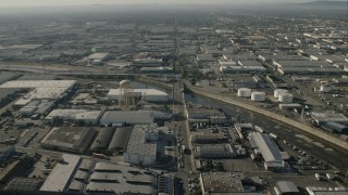 CAP_004_022 - HD stock footage aerial video warehouses, water tower, and LA River in Vernon, California