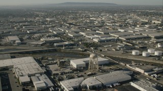 CAP_004_023 - HD stock footage aerial video of warehouses and a water tower by LA River in Vernon, California