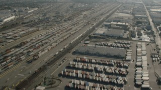 CAP_004_025 - HD stock footage aerial video flyby rows of shipping containers at a train yard in Vernon, California