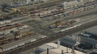 CAP_004_026 - HD stock footage aerial video of passing shipping containers at a train yard, Vernon, California