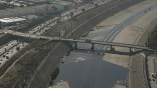 CAP_004_028 - HD stock footage aerial video of a bridge spanning the LA River in Bell, California