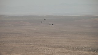 CAP_005_003 - HD stock footage aerial video of military helicopters over the Mojave Desert, California