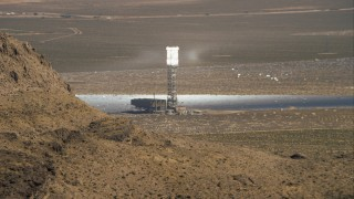CAP_005_007 - HD stock footage aerial video of one of the towers at Ivanpah Solar Electric Generating System, Mojave Desert, California