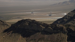 CAP_005_009 - HD stock footage aerial video of solar towers at the Ivanpah Solar Electric Generating System, Mojave Desert, California