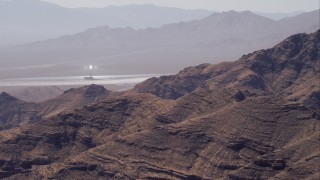 CAP_005_014 - HD stock footage aerial video of zoom tighter on one of the solar towers, Ivanpah Solar Electric Generating System, Mojave Desert, California