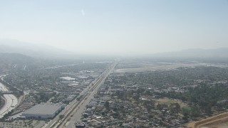 CAP_006_001 - Aerial stock footage of HD aerial  video of neighborhoods and warehouse buildings near Burbank Airport, California