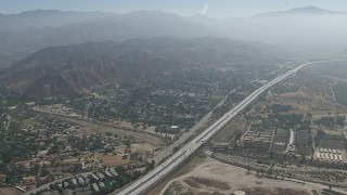 CAP_006_004 - HD stock footage aerial video of suburban neighborhoods and the 210 freeway in Lake View Terrace, California