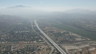 CAP_006_005 - HD stock footage aerial video of flyby suburban neighborhoods and the 210 freeway in Lake View Terrace, California
