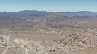 CAP_006_010 - HD stock footage aerial video of neighborhoods near the California Aqueduct and mountains in Palmdale, California