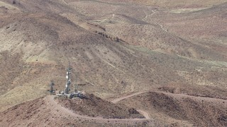 CAP_006_018 - HD stock footage aerial video of a reverse view of radio towers and Mojave Desert mountains in San Bernardino County, California