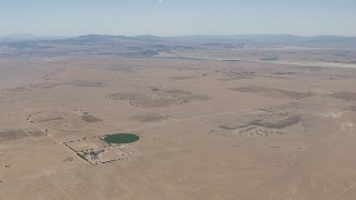 CAP_006_021 - HD stock footage aerial video of a crop field and a Mojave Desert monastery in Newberry Springs, California