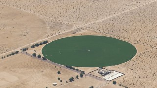 CAP_006_022 - HD stock footage aerial video of a crop field beside a Mojave Desert monastery in Newberry Springs, California