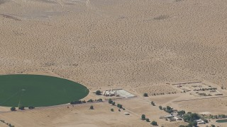 CAP_006_026 - HD stock footage aerial video zoom to a wiper view of a Mojave Desert monastery and crop circle in Newberry Springs, California