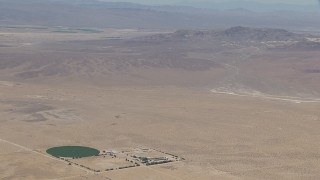 CAP_006_027 - HD stock footage aerial video zoom to a wiper view of a lonely Mojave Desert monastery and crop circle in Newberry Springs, California